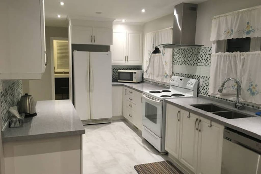 Shared large Kitchen with Fridge, Cooking Range (oven incl), Microwave, and Dishwasher