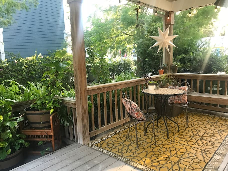 Private side porch with Edison bulb lights and cozy hammock swings. Enjoy our beautiful year-round weather in this amazing space.