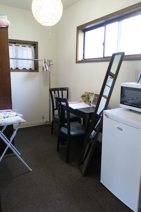 Extra room with refrigerator,  microwave oven and kettle