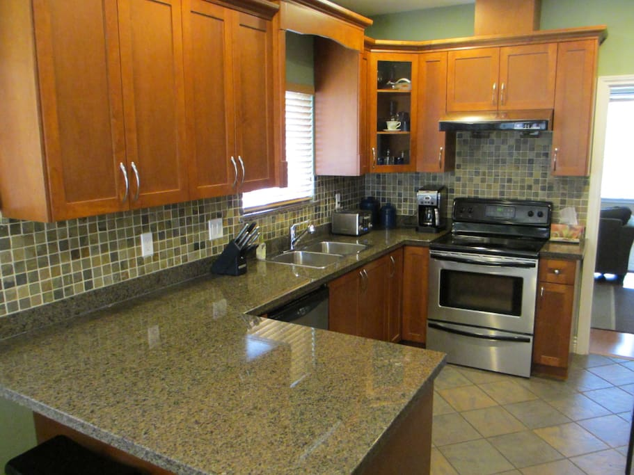 Bright, spacious kitchen, granite countertops, stainless steel appliances