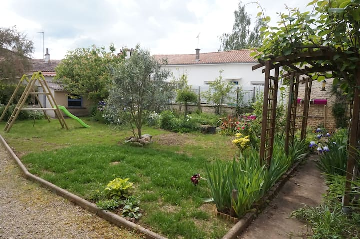 Comfortable large room in house with garden