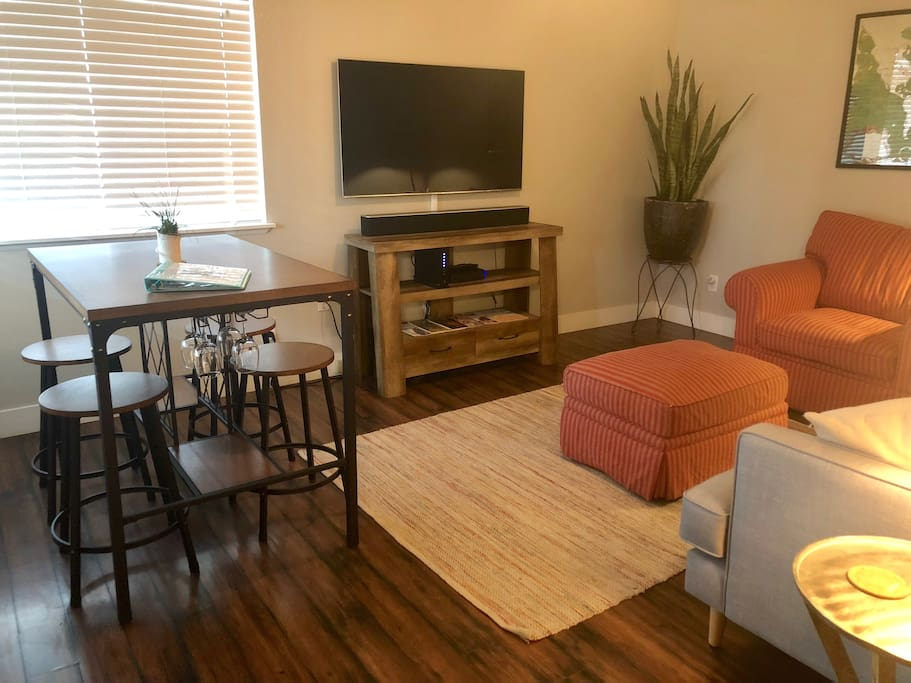 Large Smart TV with Cable. Dining Nook.