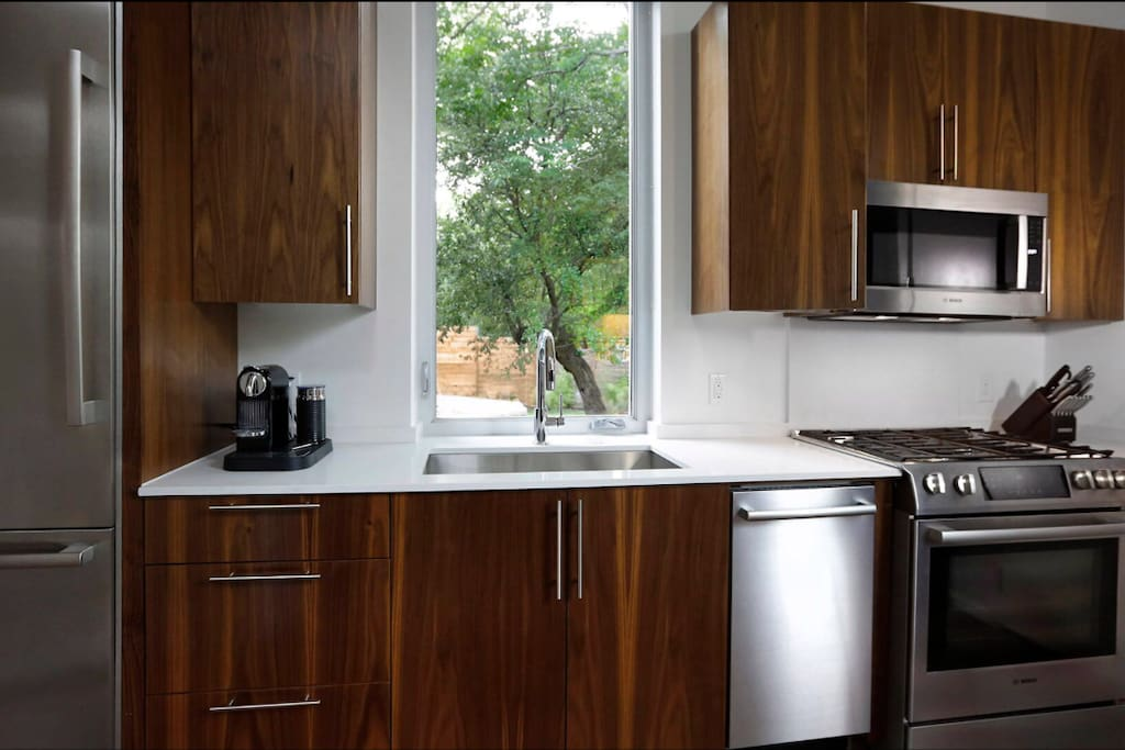 Bosch appliances, walnut cabinets and convenient coffee by Nesspresso. I usually have some local brews in the fridge. The kitchen is stocked with basic cooking utensils to make meals.