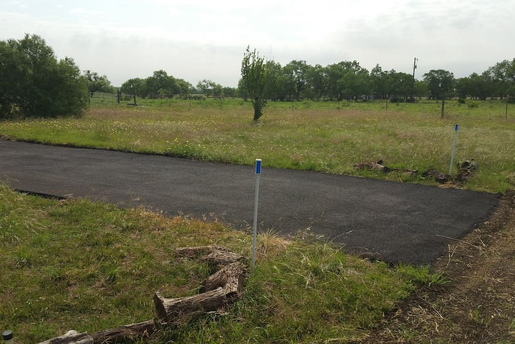 The Southfarthing is the section of lawn adjacent to the highway.  It is the largest lot and has a 50 foot paved parking space suitable for larger RV's.