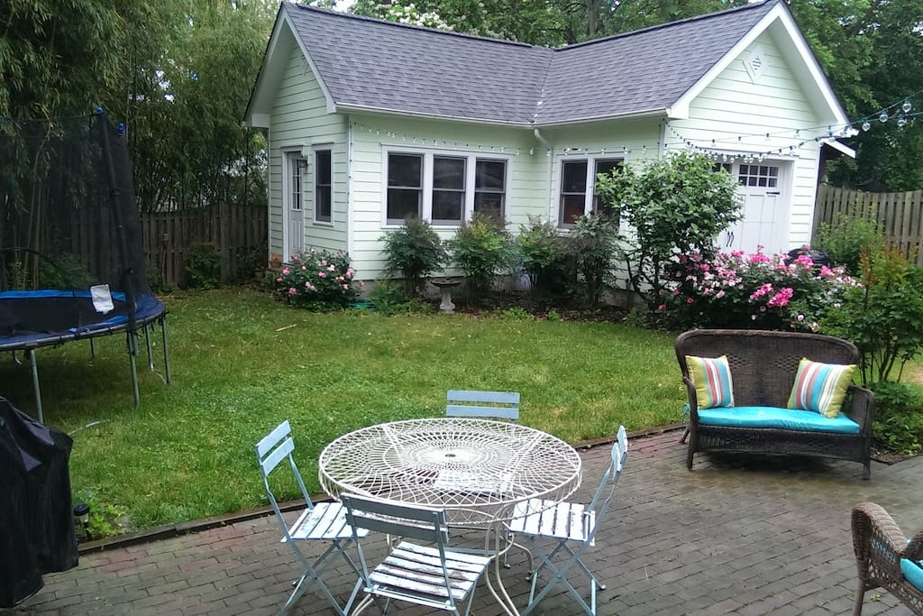 Back yard with trampoline, patio, grill and outdoor fireplace
