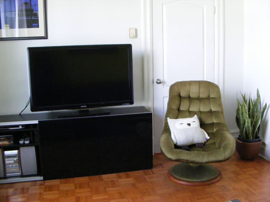Separate living room with wide screen T.V.
