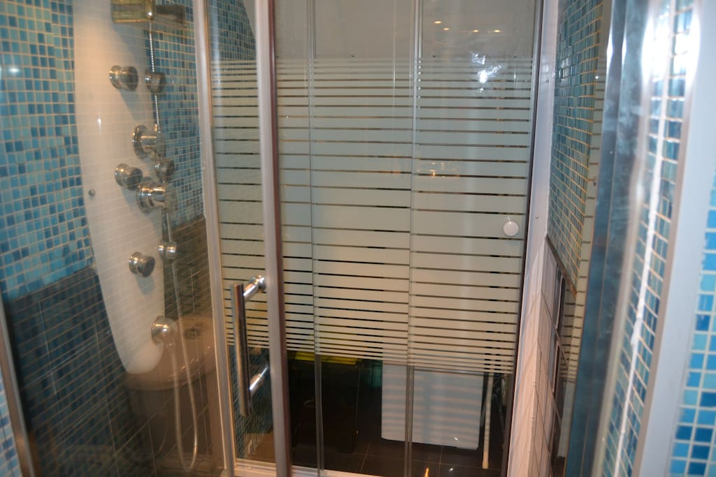 Partial view of bathroom with shower
