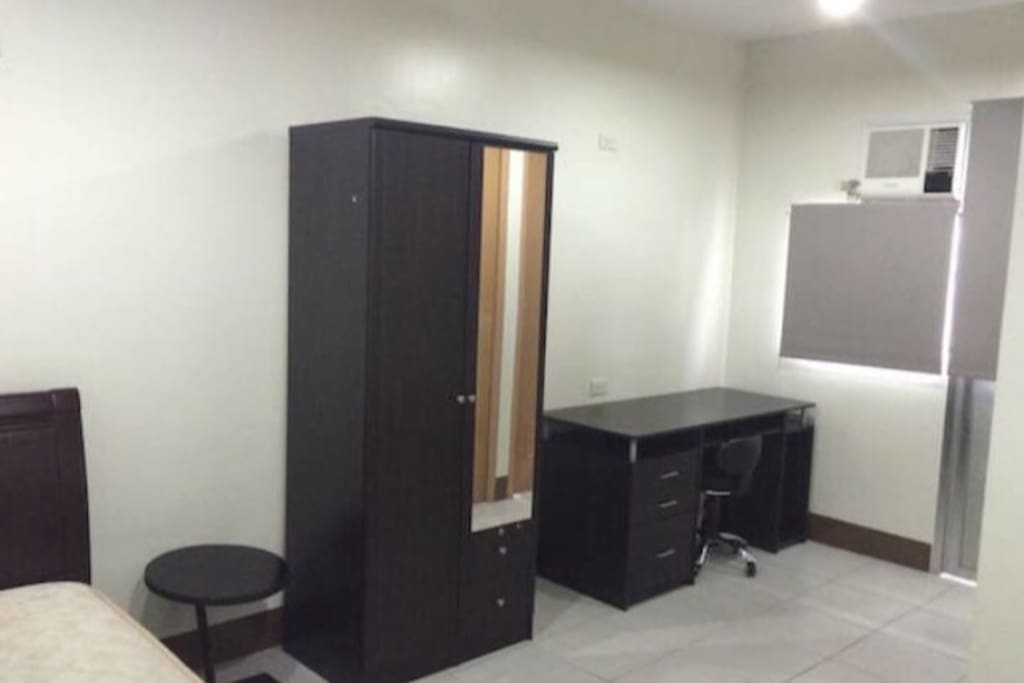 Cupboard, bedside table, computer desk and chair. Air conditioning is also included.