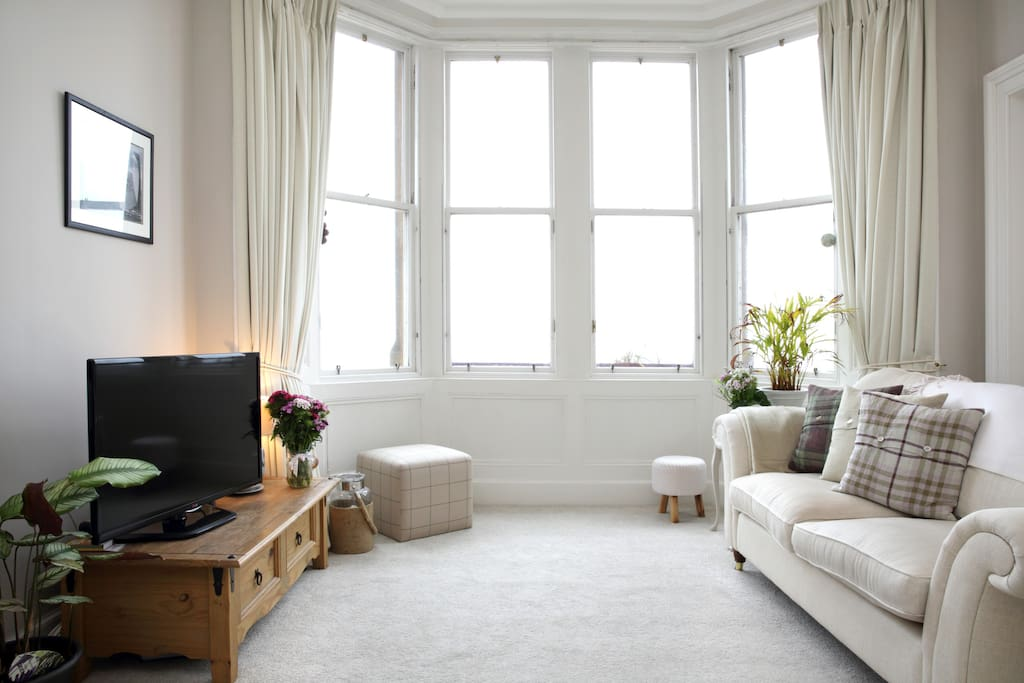 Lounge with bay window and views to the sea