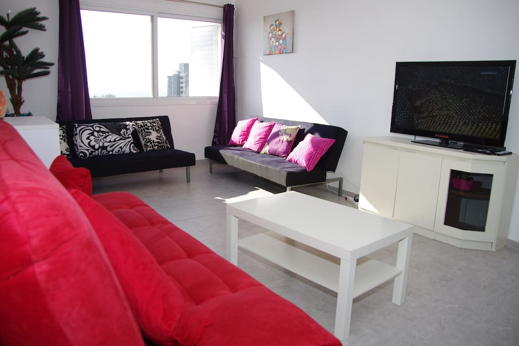 Living room (2nd photo) - sky TV with all international channels available and high-speed wifi
