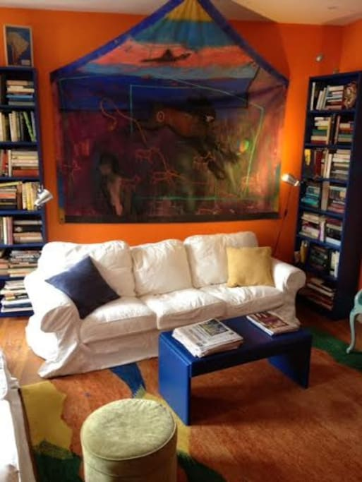 Bold, colorful artist designed color scheme and original artwork throughout the house