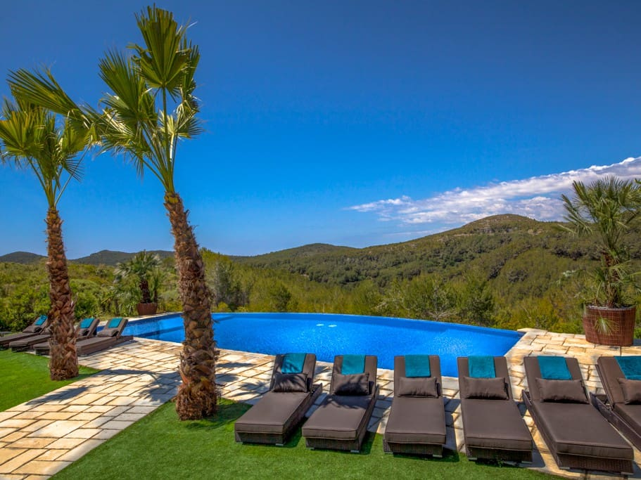 Luxurious sun beds surround the pool