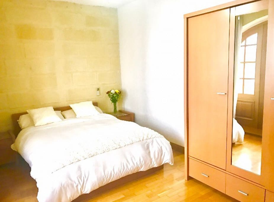 Bedroom with triple wardrobe