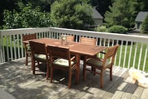 Deck, off of breakfast room. There is a propane grill on the deck. Stairs lead down the backyard and tire swing.