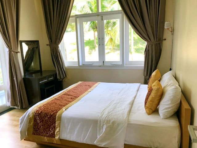 Another bedroom with queen size bed and private bathroom, garden view with plenty of sunshine