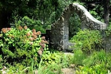 Stone archway at front of house.