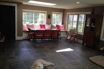 Dining Area. Part of very large sunroom that includes living area with couch and TV.
