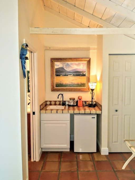 Wet bar with small fridge, coffee pot and  complimentary coffee.