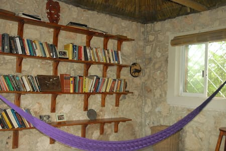 Majanail, stone/thatched Maya home