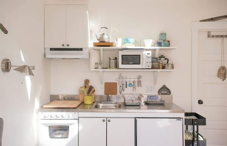 Stove, microwave, refrigerator & freezer.