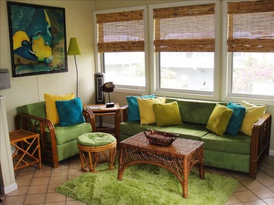 Living Room features bright Caribbean colours with local artwork, fully equipped with flat screen TV, DVD and Stereo system