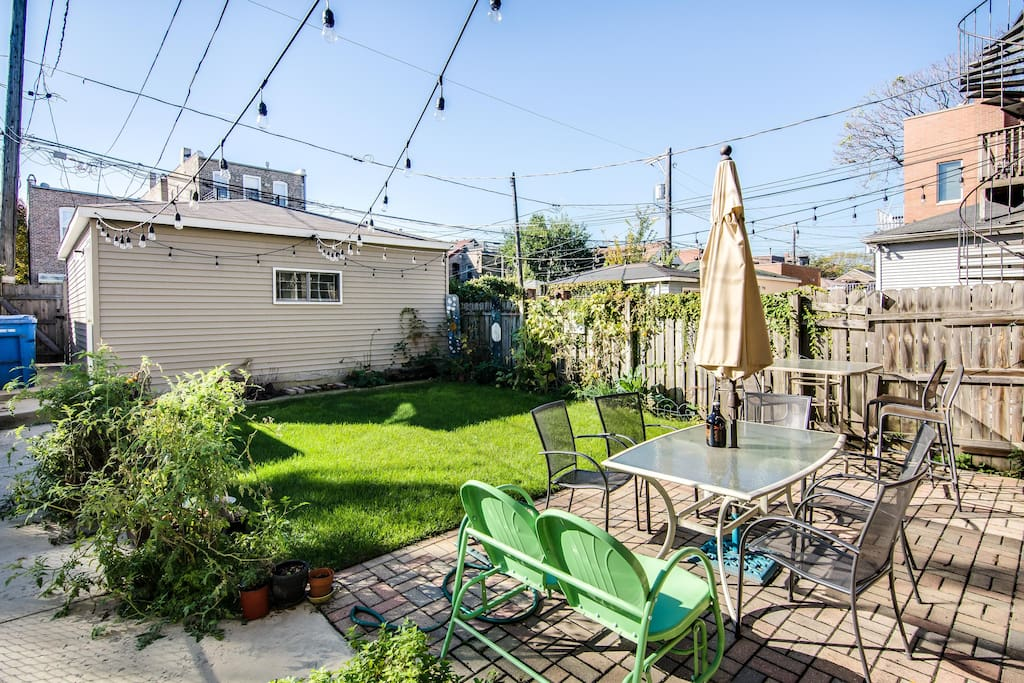 Out back is a beautiful yard and patio - an especially nice place to have a meal if you'll be visiting in summer