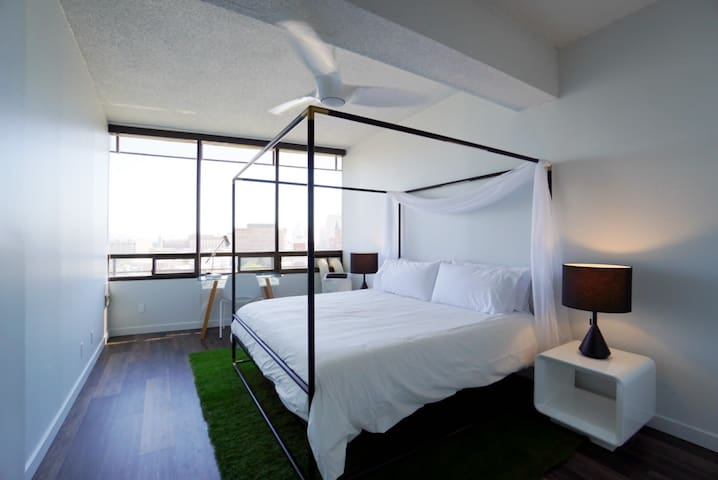 Master Bedroom- King canopy bed with desk overlooking the city!