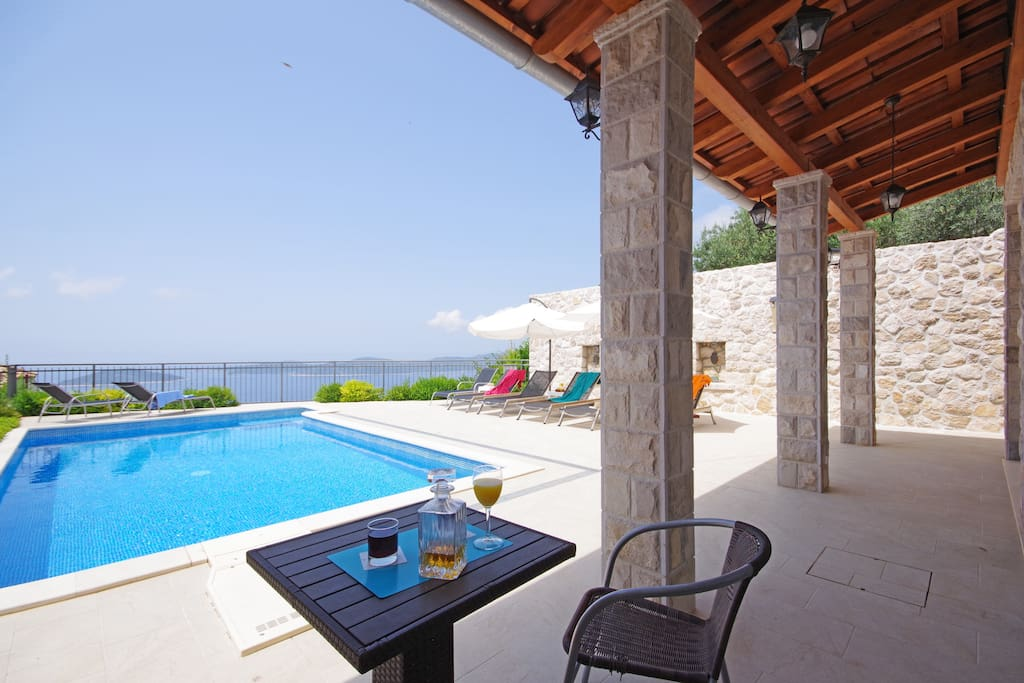 Enjoy your drink by the pool looking at the endless Adriatic sea
