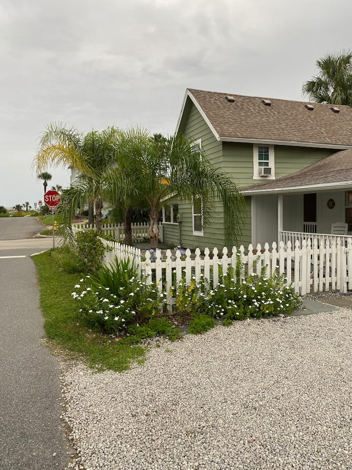 Charming Beach cottage with white picket fence.