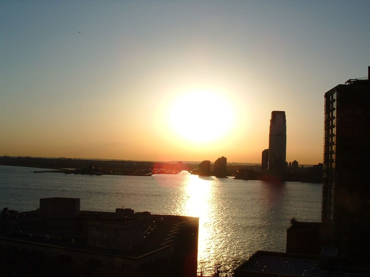 Sunset over Hudson River from terrace (with Jersey City and Liberty State Park in background)