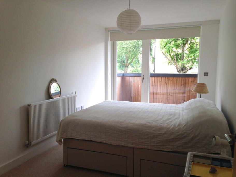 Double bedroom with balcony overlooking bermondsey gardens