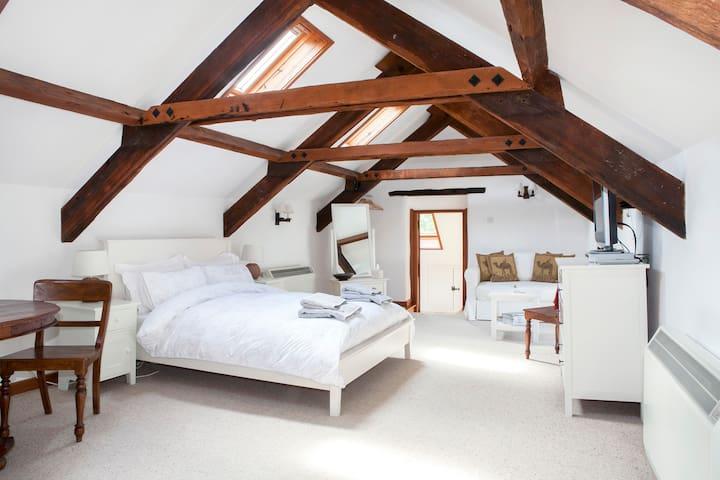 Open plan first floor bedroom and living area