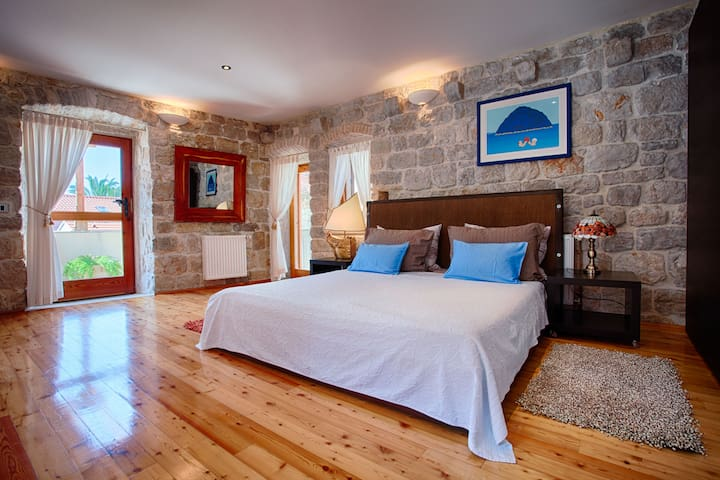 Masterbedroom with private terrace and sea view