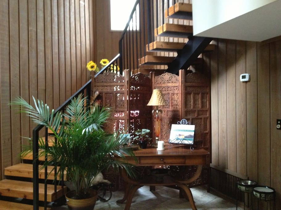 Foyer stairs to guest room.
