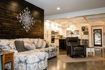 Relax on the soft recliner chair or chasie lounge couch in this open living room.