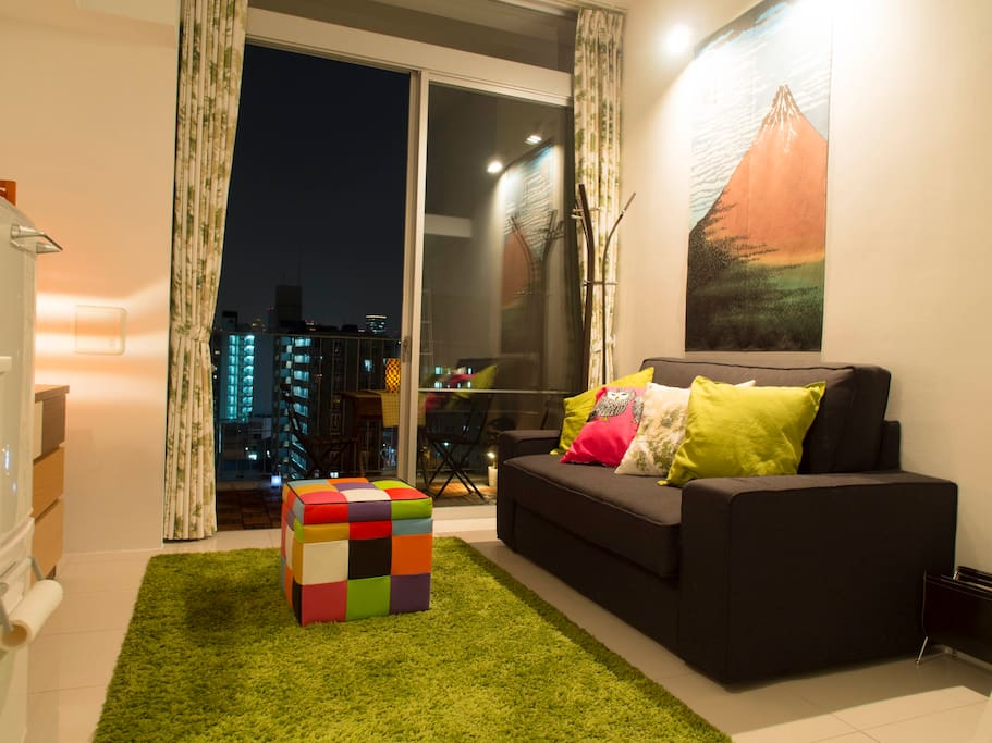 Super-sexy living space leading out to a spacious balcony with a view of Osaka's famous Dotonbori River!