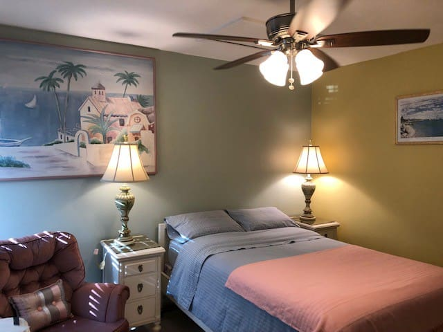 This room is ideal for a couple - has great view of beautiful back yard.