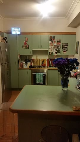 Large fully equipped kitchen with breakfast bench.