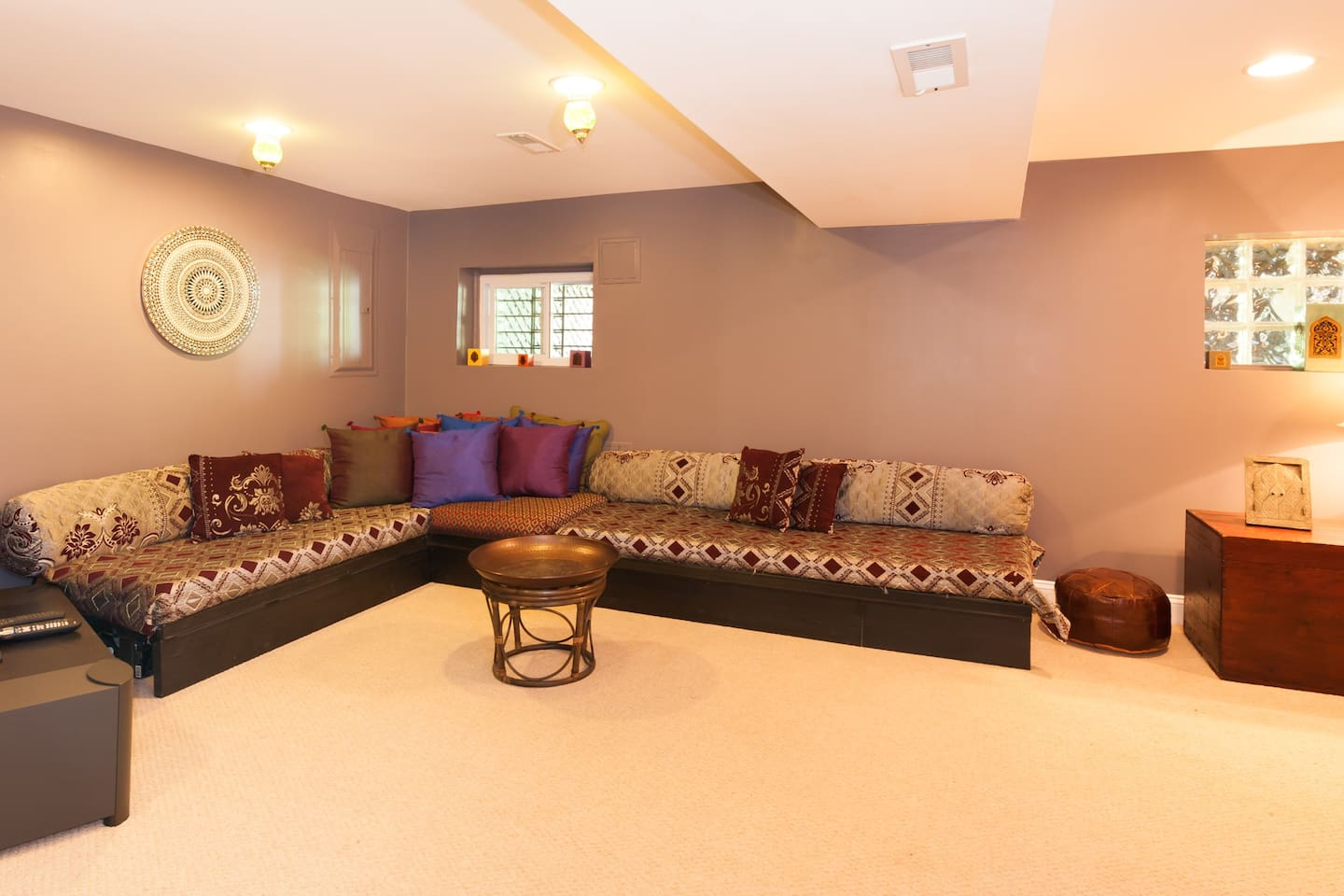 Moroccan style den with 2 couches that can double as beds. Private entry