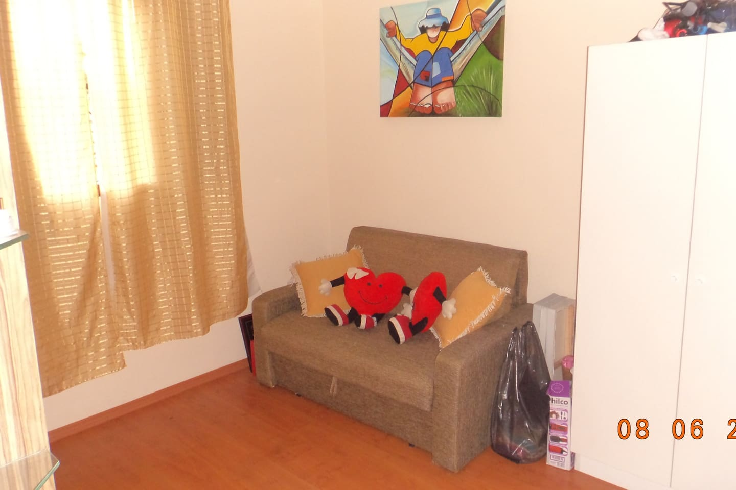 This is our guest room. In the background there is a sofa bed