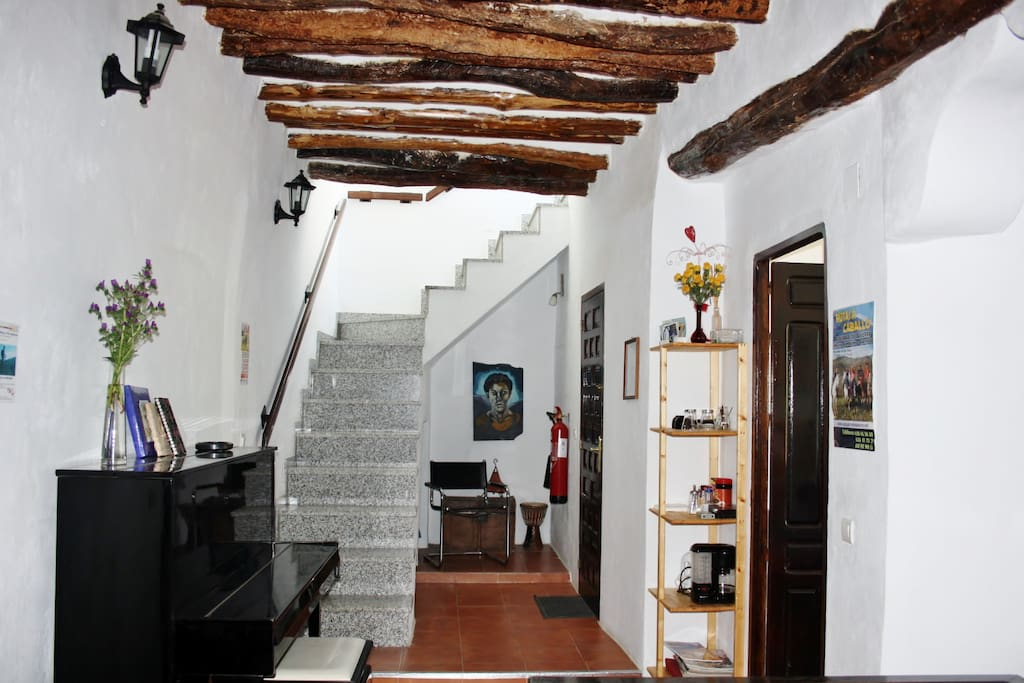 Hallway with piano and stairs to the roof terrace