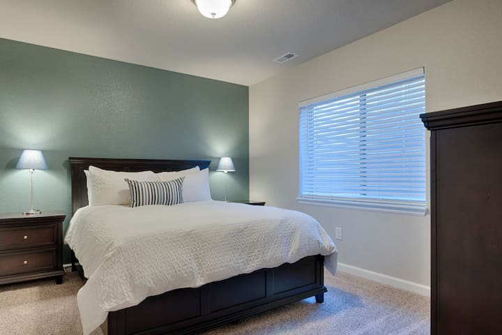 Queen sized foam mattress. This bedroom is located on the lower level of the home.
