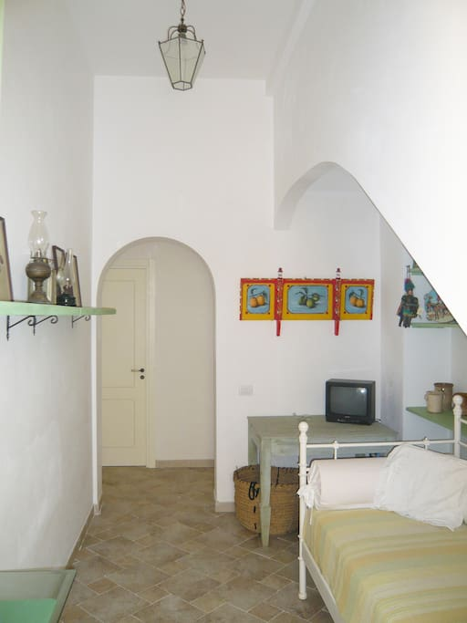 The corridor leading to the bedrooms and part of the extra single bed