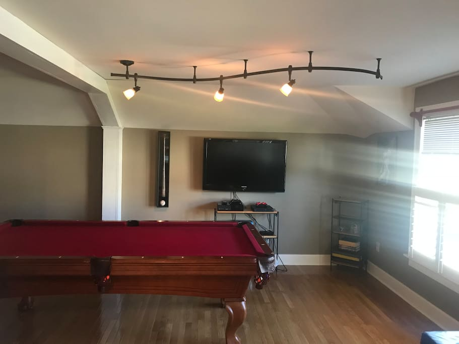 Regulation size pool table and entertainment area with cable tv Xbox One, PlayStation 4, and plenty of movies and games.