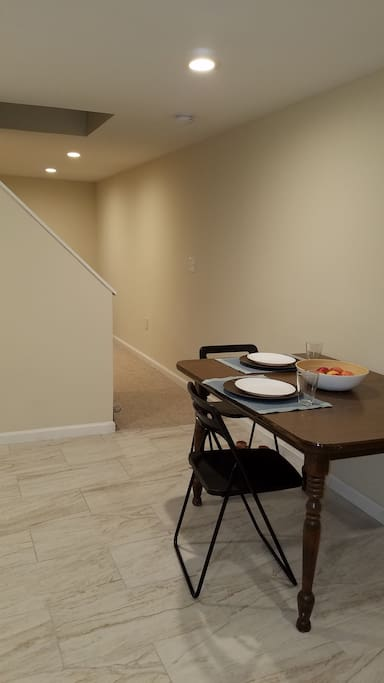 Although the space is a studio, the kitchen and living/bedroom area are separated visually by the stairs.