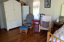 Large armoire, comfortable chairs, thoughtful, ample lighting and surface space. Refrigerator/freezer. En-suite half-bath and access to full-bath.