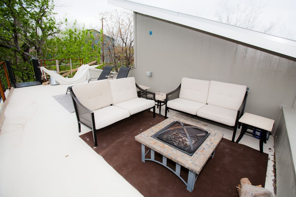 2nd floor deck with a firepit and tons of seating, perfect for entertaining