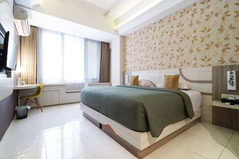 Modern Deluxe Room at Dewarna Hotel & Convention