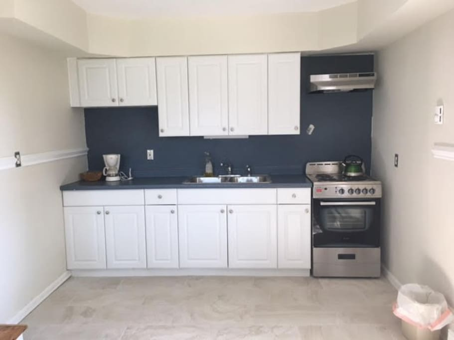 Large well lit kitchen with new porcelain tile floor and dinette
