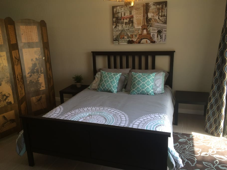 Very comfortable Queen size bed with solid wood bed frame located in the loft area.